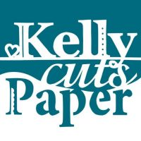 Kelly Cuts Paper